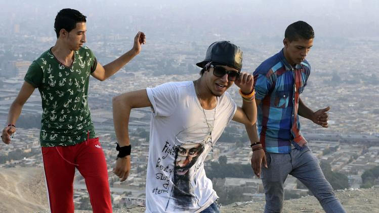 Egyptian youths practise rapping at a hilly area overlooking Cairo