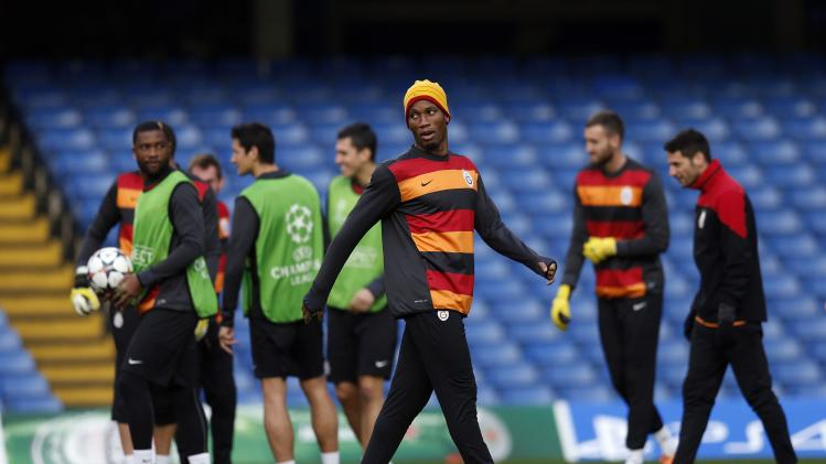Galatasaray's Drogba arrives for a training session at Stamford Bridge in London
