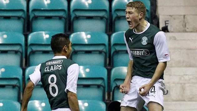 ibernian's David Wotherspoon (R) jumps in the air as he celebrates with team mate Jorge Claros after scoring against Hearts
