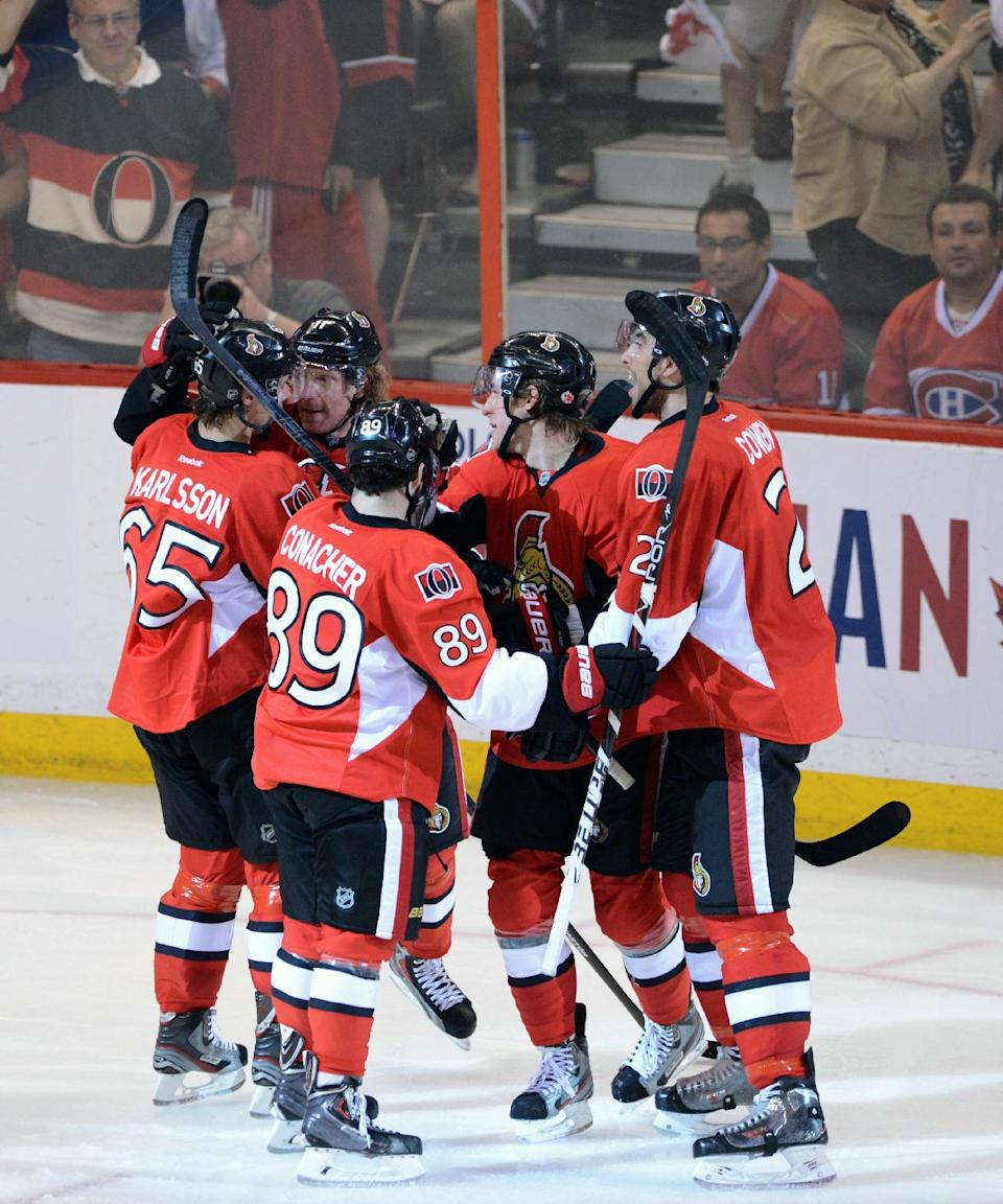 Ottawa Senators players celebrate a goal by Kyle Turris against the Montreal Canadiens during the third period of Game 3 of their first-round NHL hockey Stanley Cup playoff series, Sunday, May 5, 2013, in Ottawa, Ontario. (AP Photo/The Canadian Press, Sean Kilpatrick)