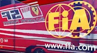 A Ferrari Scuderia logo is reflected on a FIA truck at the Istanbul Park racetrack in Istanbul, June 4, 2009. REUTERS/Umit Bektas/Files