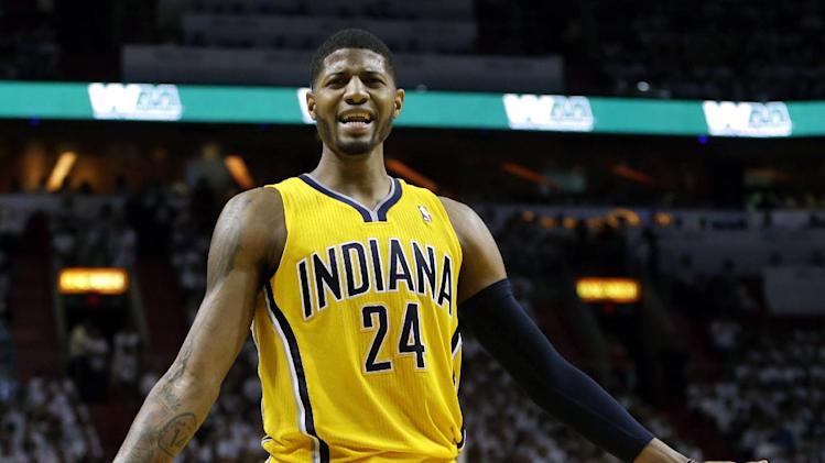 Indiana Pacers forward Paul George (24) reacts to a call during the first half of Game 1 in their NBA basketball Eastern Conference finals playoff series against the Miami Heat, Wednesday, May 22, 2013 in Miami. (AP Photo/Lynne Sladky)