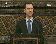 Syrian President Bashar al-Assad addresses the parliament in Damascus on June 3. Russia says it is preparing to see Assad leave power in a negotiated solution to 15 months of bloodshed that has claimed more than 13,000 lives