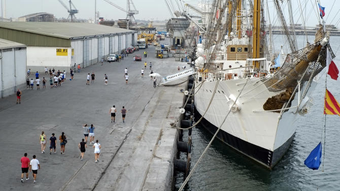 The crew of the flagship of Argentina's navy, the A.R.A. Libertad, run along the dock at the port of Tema, outside Accra, Ghana, Thursday, Oct 11, 2012, where the Libertad is being held by a judge answering a complaint from a U.S. hedge fund. A Ghanaian court ruled today against releasing the vessel because of action against the Argentine state by creditors in the United States. The U.S. creditors are demanding payment in full for Argentine bonds for which most investors accepted 30 cents on the dollar in 2005. (AP Photo / Michael A. Mariant)
