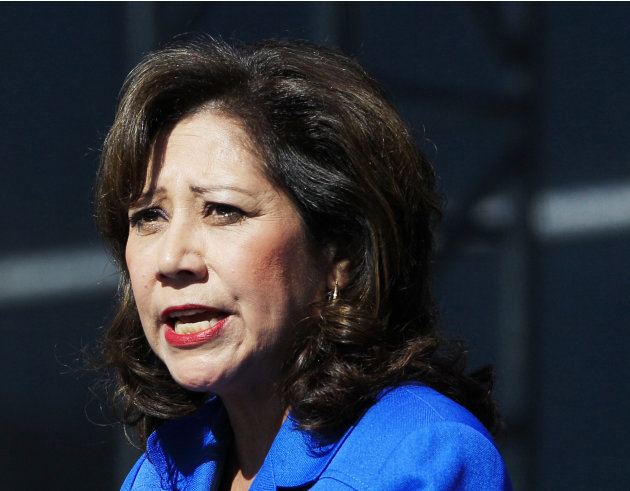 FILE - This Sept. 10, 2012 file photo shows Labor Secretary Hilda Solis addresses employees outside the Flat Rock Assembly in Flat Rock, Mich. Solis told colleagues she is resigning from Obama adminis