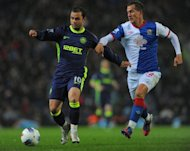 Blackburn Rovers' Morten Gamst Pedersen (R) fights for the ball with Wigan Athletic's Shaun Maloney during their English Premier League match at Ewood Park in Blackburn, on May 7. Blackburn play Chelsea next, at Stamford Bridge, on Sunday