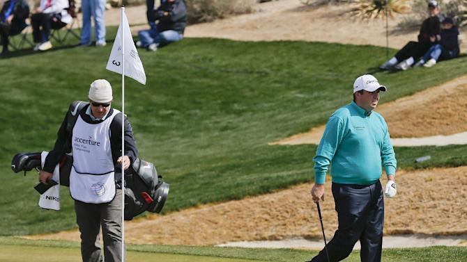 Ireland's Shane Lowry walks off the third green after putting during the second round against Sweden's Carl Pettersson during the Match Play Championship golf tournament, Friday, Feb. 22, 2013, in Marana, Ariz. Lowry won 6 and 5. (AP Photo/Ross D. Franklin)