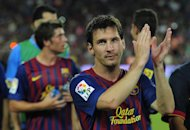 FC Barcelona's Lionel Messi from Argentina waves after the Joan Gamper trophy against Napoli at the Camp Nou stadium in Barcelona, Spain, Monday, Aug. 22, 2011. (AP Photo/Manu Fernandez)