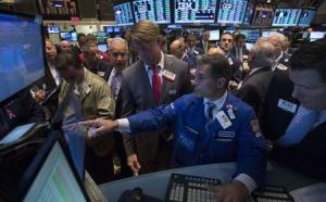 Traders wait for the opening of Oi SA during its debut on the New York Stock Exchange