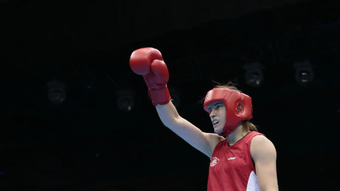 Ireland's Katie Taylor reacts following a fight against Tajikistan's Mavzuna Chorieva in a women's semifinal lightweight 51-kg boxing match at the 2012 Summer Olympics, Wednesday, Aug. 8, 2012, in London. (AP Photo/Ivan Sekretarev)