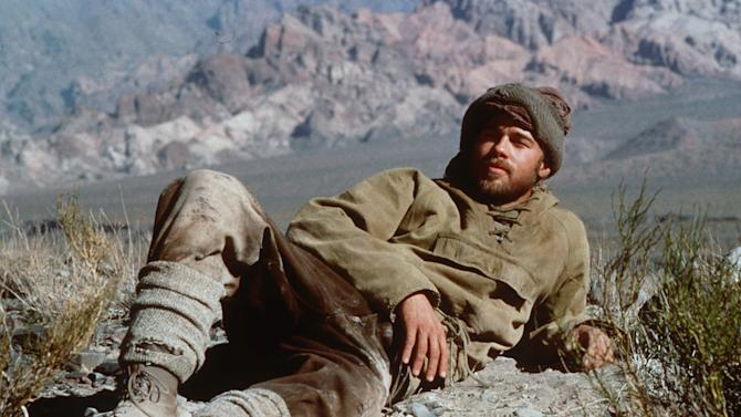 "FILE - In this undated photo, actor Brad Pitt in his role as Austrian mountaineer and former Nazi party member Heinrich Harrer reclines on a mountain ledge during the filming of "" Seven Years in Tibet."" Pitt is now on China's version of Twitter, and his mysterious first tweet has drawn thousands of comments. The actor's verified Sina Weibo account sent the message Monday, Jan. 7, 2013: ""It is the truth. Yup, I'm coming."" That was forwarded more than 31,000 times and netted over 14,000 comments, many expressing surprise. He gathered more than 100,000 followers. (AP Photo/David Appleby, File)"