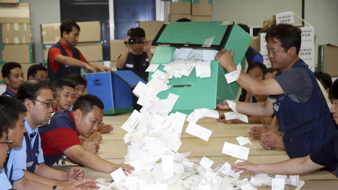 In this Tuesday, Aug 13, 2013 photo, members of labor unions at Hyundai Motor open ballots after they voted to decide on unions to go on strike at their firm's plant in Ulsan, south of Seoul, South Korea. Labor unions at Hyundai Motor and its affiliate Kia Motors said workers voted to strike after talks with management for increased pay and benefits collapsed. Hyundai union spokesman Kwon Oh-il said Wednesday that management refused all demands by the union during three months of annual talks. (AP Photo/Kim Keun-ju, Yonhap) KOREA OUT