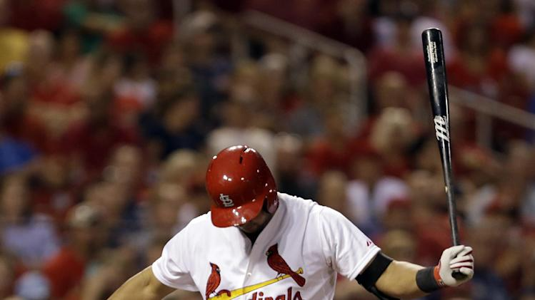 St. Louis Cardinals' Jhonny Peralta walks back to the dugout after striking out swinging during the fourth inning of a baseball game against the Tampa Bay Rays Tuesday, July 22, 2014, in St. Louis. (AP Photo/Jeff Roberson)