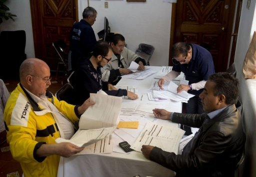 <p>Federal Electoral Institute (IFE) personnel fill the electoral certificates at the end of the vote recount of the past presidential election in Mexico City. Mexico's Enrique Pena Nieto hoped definitive election results expected Thursday would officially crown him president-elect, while challenger Andres Manuel Lopez Obrador held out for a shock reversal.</p>