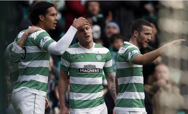 Celtic's Stokes is congratulated on scoring against St Johnstone by teammates during their Scottish Premier League match in Glasgow