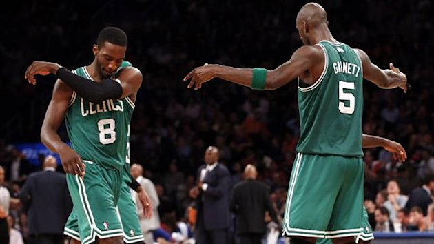 Boston Celtics' Kevin Garnett (R) celebrates with Jeff Green after Green made a three point basket late in the fourth quarter against the New York Knicks in Game 5 of their NBA Eastern Conference basketball play-off series (Reuters)