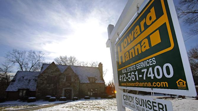 FILE - In this Thursday, Jan. 9, 2014, file photo, a for sale sign hangs in front of a house in Mount Lebanon, Pa. Freddie Mac, the mortgage company, releases weekly mortgage rates on Thursday, March 20, 2014. (AP Photo/Gene J. Puskar, File)