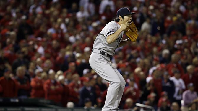 Boston Red Sox relief pitcher Koji Uehara reacts after getting St. Louis Cardinals' Matt Holliday to fly out and end Game 5 of baseball's World Series Monday, Oct. 28, 2013, in St. Louis. The Red Sox won 3-1 to take a 3-2 lead in the series