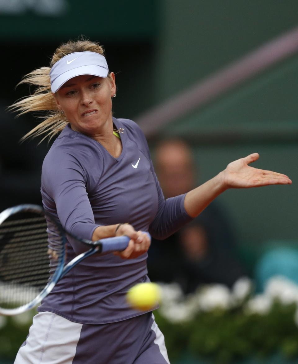 Russia's Maria Sharapova returns the ball to Canada's Eugenie Bouchard during their second round match of the French Open tennis tournament at the Roland Garros stadium Thursday, May 30, 2013 in Paris.  (AP Photo/Petr David Josek)