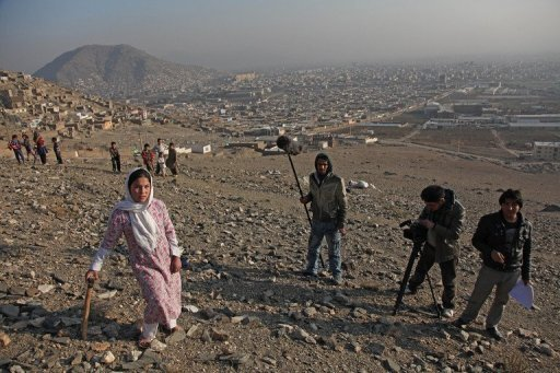 """Members of the crew from the movie """"Kabul I Love You"""" film in Kabul. A decade after the fall of the cinema-hating Taliban, a group of Afghan directors have created a film love letter to their capital, rooted in the grim reality of everyday life in the war-torn city"""