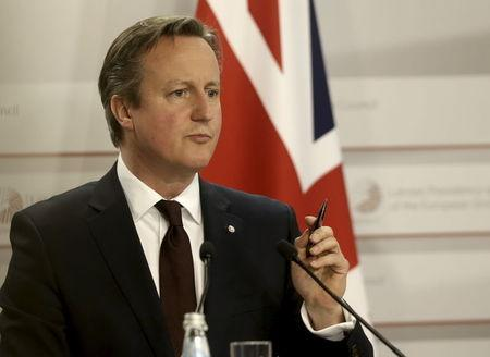 Britain's Prime Minister Cameron gestures as he speaks at a news conference after the Eastern Partnership Summit in Riga