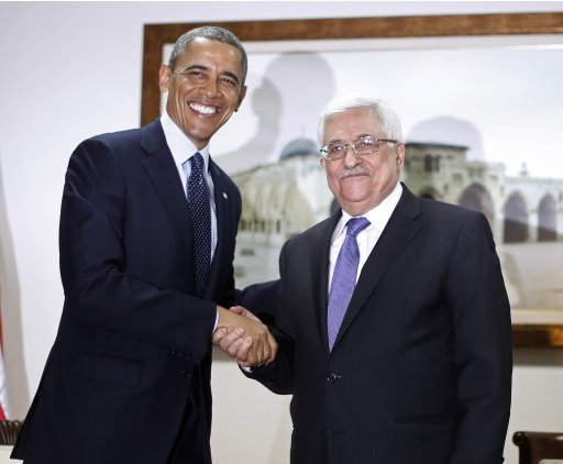 U.S. President Obama shakes hands with Palestinian President Abbas during their bilateral meeting in Ramallah