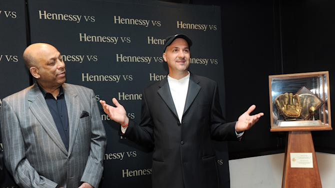 IMAGE DISTRIBUTED FOR HENNESSY V.S - Baseball Hall of Fame member Orlando Cepeda, left, and Duane Rieder, Executive Director of the Clemente Museum, attend the Hennessy V.S Latinos in Baseball event at the Parlor in New York, Thursday, June 27, 2013. This marked the first time Roberto Clemente memorabilia traveled outside of the Clemente Museum in Pittsburgh. (Photo by Diane Bondareff/Invision for Hennessy V.S/AP Images)