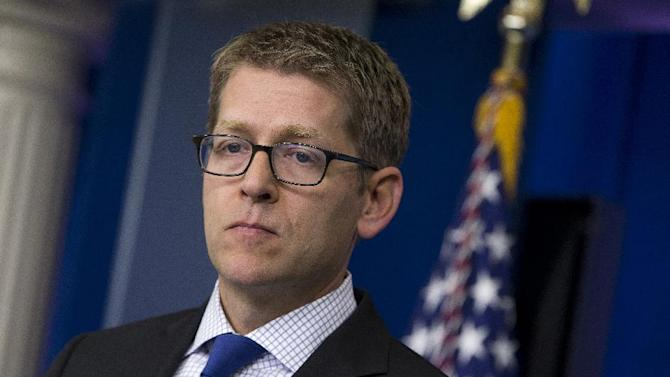 White House press secretary Jay Carney pauses during the daily press briefing at the White House in Washington, Monday, June 24, 2013. Carney said the U.S. assumes that Edward Snowden is now in Russia and that the White House now expects Russian authorities to look at all the options available to them to expel Snowden to face charges in the U.S. for releasing secret surveillance information . (AP Photo/Evan Vucci)