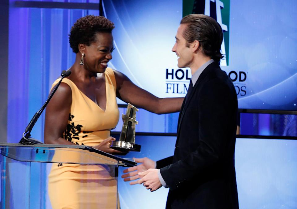 Viola Davis, left, presents the Hollywood supporting actor award to Jake Gyllenhaal at the 17th Annual Hollywood Film Awards Gala at the Beverly Hilton Hotel on Monday, Oct. 21, 2013, in Beverly Hills, Calif. (Photo by Todd Williamson/Invision/AP)