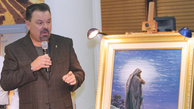 "FILE - In this Sept. 15, 2006 file photo, artist Thomas Kinkade unveils his painting, ""Prayer For Peace,"" at the opening of the exhibit ""From Abraham to Jesus,"" in Atlanta.  Kinkade, 54, the self-described ""Painter of Light,"" died April 6 at his home in Los Gatos, Calif. (AP Photo/Gene Blythe, File)"