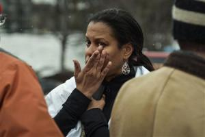 William of Lanham, Maryland reacts after she was evacuated from a building following a shooting at a shopping mall in Columbia