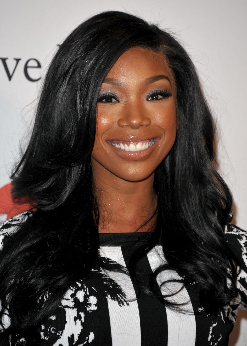 Recording artist Brandy arrives at the Clive Davis Pre-GRAMMY Gala on Saturday, Feb. 9, 2013 in Beverly Hills, Calif. (Photo by John Shearer/Invision/AP)