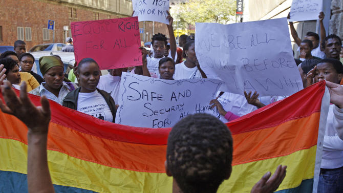 FILE In this May 20, 2010 file photo, women protest against a sentence of 14 years in prison, with hard labor, given to two men in Malawi under Malawi's anti-gay legislation, in the city of Cape Town, South Africa, Thursday, May 20, 2010. The U.S. embassy in Abidjan made history in June 2013 by hosting a gay pride reception attended by about two dozen openly gay Ivorians. Despite the groundbreaking nature of the event, reporters were barred from attending, and the only mention of it was a short blurb on the embassy website posted the following week. The discreet handling of the event encapsulates the Obama administration's cautious promotion of gay rights in Africa, an issue that is likely to come up during his visit beginning June 26, 2013 to three African nations, two of which punish homosexuality with jail time. (AP Photo/Schalk van Zuydam, File)