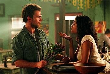 Seann William Scott as Travis and Rosario Dawson as Mariana in Universal's The Rundown