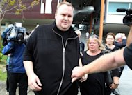 Megaupload boss Kim Dotcom leaves a court in Auckland on February 22. New Zealand police said Monday they were investigating allegations that a government minister tried to hide campaign donations from Dotcom