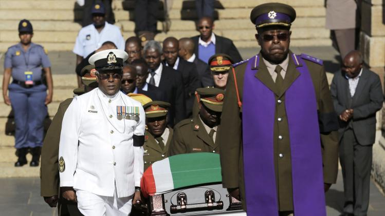 Military officers carry the coffin of former South African President Nelson Mandela at the Union Buildings for the second day of lying in state in Pretoria