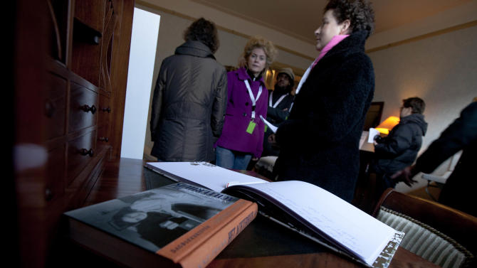 "FILE - In this Saturday Dec. 10, 2011 file photo Anne Frank's diary is seen on her writing desk as visitors tour the first house of Anne Frank in Amsterdam, Netherlands, where the Frank family lived from 1933 to 1942 before going into hiding into The Secret Annex. Two nonprofit organizations, The Anne Frank Fund, based in Basel, Switzerland and The Anne Frank Foundation, which manages the museum located in Amsterdam, are locked in a dispute over the Frank family archives, which have been kept in Amsterdam since 2007. Foundation spokeswoman Maatje Mostart said Wednesday May 8, 2013 of the fight ""it's really sad this is happening."" (AP Photo/Peter Dejong, File)"
