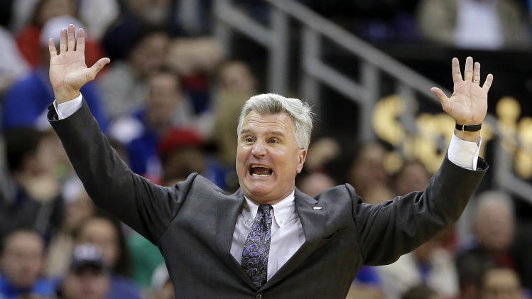 Kansas State coach Bruce Weber talks to his players during the first half of an NCAA college basketball game against Kansas for the Big 12 men's tournament title, Saturday, March 16, 2013, in Kansas City, Mo. (AP Photo/Charlie Riedel)