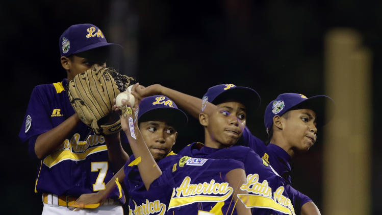 In this multiple exposure photo, Aguadulce, Panama's Luis Velis pitches in the fifth inning of a pool play baseball game against Lugazi, Uganda at the Little League World Series, Friday, Aug. 17, 2012, in South Williamsport, Pa.  (AP Photo/Matt Slocum)