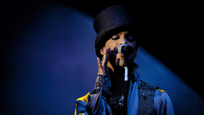 """FILE - In this Aug. 6 2011 file photo, American singer and songwriter Prince performs on the Isle of Amager in Copenhagen, Denmark. Prince now owns the rights of the music he recorded on Warner Bros. Records after years of disputes and battles with the record label. Warner Bros. announced Friday, April 18, 2014, that it reached an agreement with the pop icon. Prince was signed to label from 1978 to mid-1990s, during which he released key projects like """"Purple Rain,"""" """"1999"""" and """"Around the World In a Day."""" The financial terms of the agreement were not disclosed. (AP Photo/Polfoto/Jakob Joergensen, File) DENMARK OUT"""