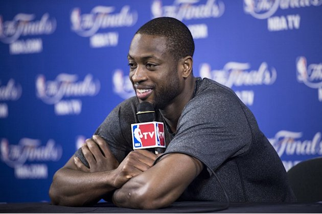 Dwyane Wade of the Miami Heat speaks to reporters on June 19, 2013 in Miami