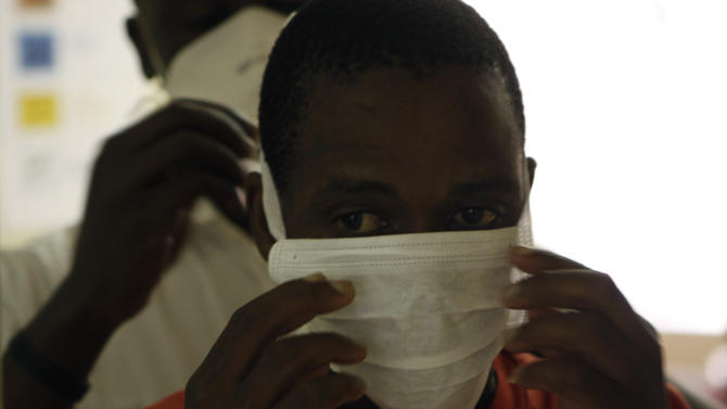 In this photo taken Thursday, Nov. 15, 2012 an unidentified patient prepares to be tested for TB, at the US sponsored Themba Lethu, HIV/AIDS Clinic, at the Helen Joseph hospital, in Johannesburg. In the early 90s when South Africa's Themba Lethu clinic could only treat HIV/AIDS patients for opportunistic diseases, many would come in on wheelchairs and keep coming to the health center until they died. Two decades later the clinic is the biggest ARV (anti-retroviral) treatment center in the country and sees between 600 to 800 patients a day from all over southern Africa. Those who are brought in on wheelchairs, sometimes on the brink of death, get the crucial drugs and often become healthy and are walking within weeks. (AP Photo/Denis Farrell)