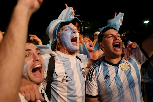 RIO DE JANEIRO, BRAZIL - JUNE 15: Argentine soccer fans cheer as they wait for their team to take to the field against Bosnia and Herzegovina as they ...