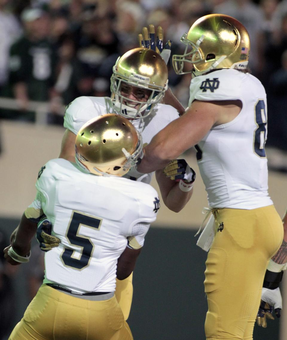 Notre Dame's John Goodman, center, Everett Golson (5) and Troy Niklas, right, celebrate Goodman's touchdown reception during the first quarter of an NCAA college football game against Michigan State, Saturday, Sept. 15, 2012, in East Lansing, Mich. (AP Photo/Al Goldis)