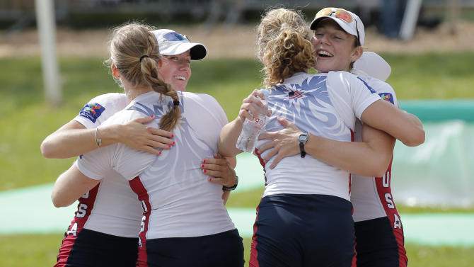 From left, USA's Kristine O'Brien, Grace Latze, Adrienne Martelli and Grace Luczak celebrate after winning the Women's four during the World rowing championships in Aiguebelette, French Alps, Friday, Sept. 4, 2015. (AP Photo/Laurent Cipriani)