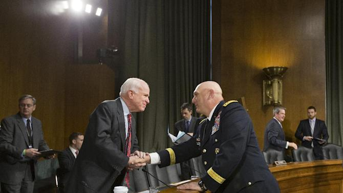 Senate Armed Services Committee member Sen. John McCain, R-Ariz., left, welcomes Army Chief of Staff Gen. Ray Odierno on Capitol Hill in Washington, Tuesday, April 23, 2013, prior to Odierno testifying before the committee's hearing on the Defense Department budget requests for fiscal year 2014.  (AP Photo/J. Scott Applewhite)