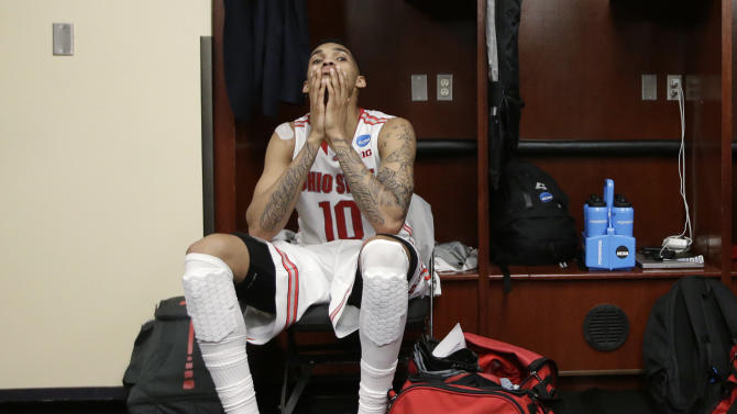 Ohio State's LaQuinton Ross sits in the locker room after his team lost 70-66 to Wichita State in the West Regional final in the NCAA men's college basketball tournament, Saturday, March 30, 2013, in Los Angeles. (AP Photo/Jae C. Hong)