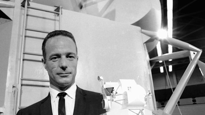 """FILE - In this March 26, 1967 file photo, astronaut Scott Carpenter poses with model of the Lunar Excursion Module (LEM) at Grumman Aircraft engineering Corp. plant in Bethpage, N.Y. Carpenter, who died Oct. 10, 2013, was one of the original Mercury 7 astronauts from the """"Right Stuff"""" days of the early 1960s. His death leaves John Glenn as the sole living member of the famed group. (AP Photo/Camerano, File)"""
