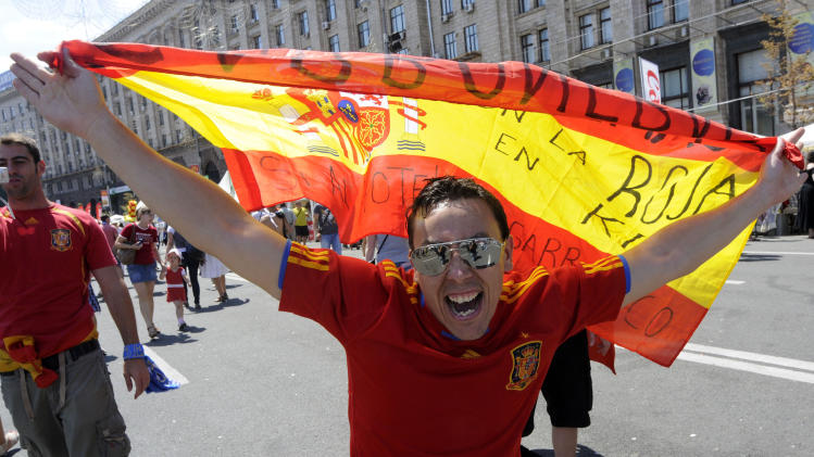 A Spain supporter cheers for his team ahead of the Euro 2012 soccer championship final match between  Spain and Italy in Kiev, Ukraine, Sunday, July 1, 2012. (AP Photo/Sergei Chuzavkov)