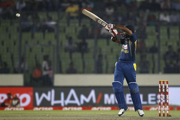 Sri Lankan cricket player Lahiru Thirimanne plays a shot during the Asia Cup final cricket match between Sri Lanka and Pakistan in Dhaka, Bangladesh, Saturday, March 8, 2014